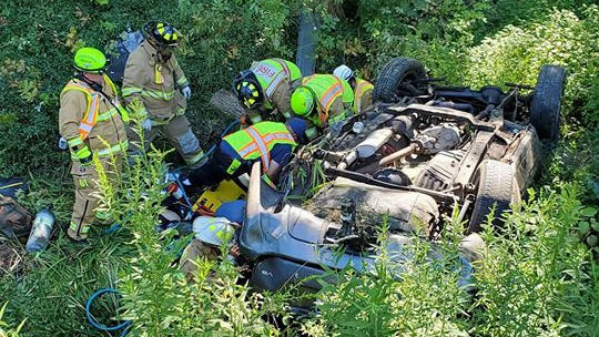 Emergency personnel respond to the scene of a fatal crash in the 10700 block of U.S. Route 19 in Waterford Township on Aug. 20.