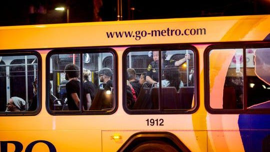 Arrested protesters are transported in a Metro bus in Cincinnati's Over-the-Rhine neighborhood on Sunday, May 31.