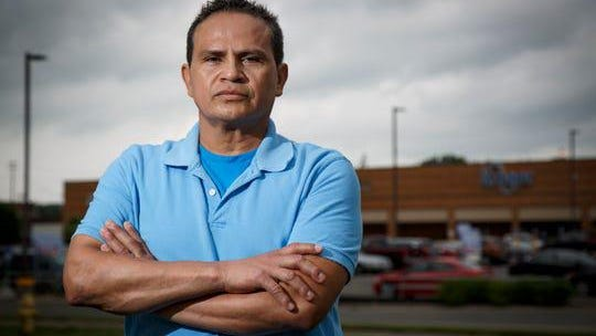 Kroger employee Miguel Angel Bonilla poses near the store he works at in the Spring Grove neighborhood of Cincinnati on Wednesday, June 10, 2020. The Spring Grove Village Kroger store saw a number of its employees test positive for COVID-19.