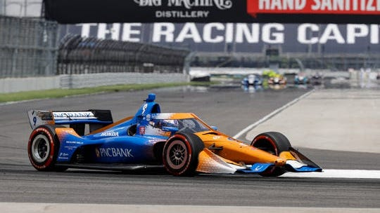 AP Photo) Scott Dixon wins the Indy Car race on the Indy Car road course on Saturday.
