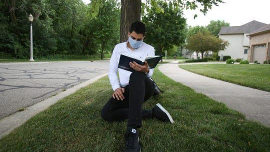 Ramy Darwish, 22, a Wayne State senior, continues his college academics online through the summer at his home in East Lansing.