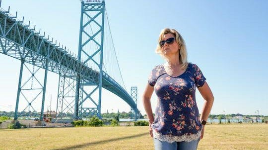 """""""I almost feel like we're being penalized because we chose this type of relationship,"""" said Kim Thompson of Ferndale, who has been separated for months from her partner who lives in Canada."""