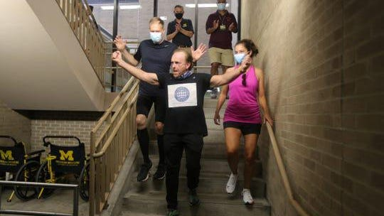 Jim Wigginton runs the steps at the Rogel Cancer Center parking structure in Ann Arbor Sunday followed by Drs. Frank Worden and Megan Haymart. Wigginton donated money in his late wife's name to the Punya Thyroid Research Center.