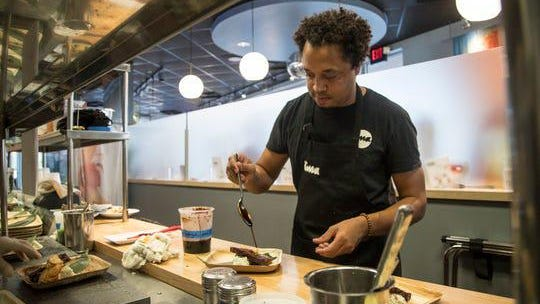 Ima owner Mike Ransom works in the kitchen of his popular Japanese noodle shop on Tuesday, August 13, 2019. The Ima location in Midtown was the only restaurant in Michigan out of 785 to receive Payroll Protection Program funds that self-identified as Black-owned.