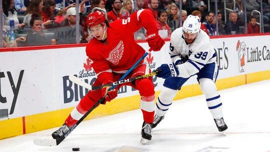 Detroit Red Wings defenseman Moritz Seider and Toronto Maple Leafs left wing Rich Clune battle for the puck in the third period at Little Caesars Arena, Sept. 27, 2019.