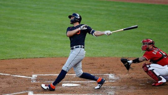 Detroit Tigers left fielder JaCoby Jones (21) follows through on a swing as he hits a two-run home run in the second inning of a preseason game between the Cincinnati Reds and the Detroit Tigers at Great American Ball Park in downtown Cincinnati on Tuesday, July 21, 2020.