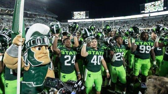 Michigan State players sing the fight song with Sparty, after the 51-17 win over Western Michigan at Spartan Stadium in East Lansing, Saturday, September 7, 2019.