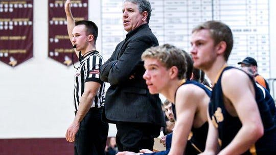 Pewamo-Westphalia coach Luke Pohl (second from left) is retiring after 23 years as varsity head coach.