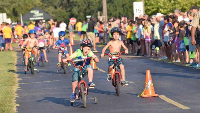 Kids pedal their way to the finish line Saturday during the cycling portion of the Wild Kidz Triathlon at Louisiana State University of Alexandria. About 300 children participated in the event.