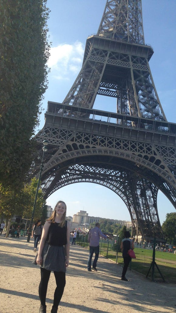 Kelsey Cook '16 poses in front of the Eiffel Tower during her semester in Paris, France. (Photo courtesy of Kelsey Cook)
