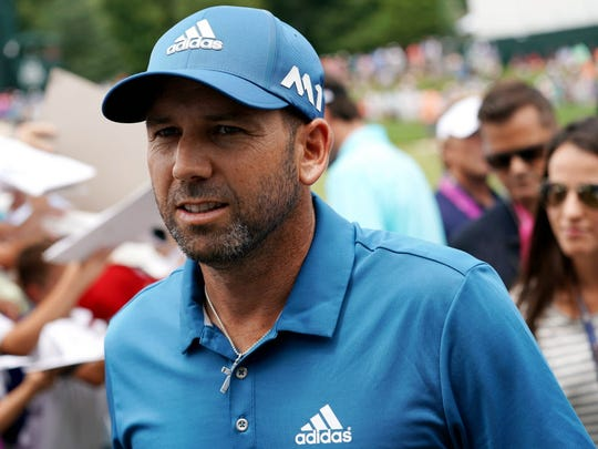 Sergio Garcia leaves the 18th green during a practice round for the 2017 PGA Championship at Quail Hollow Club.