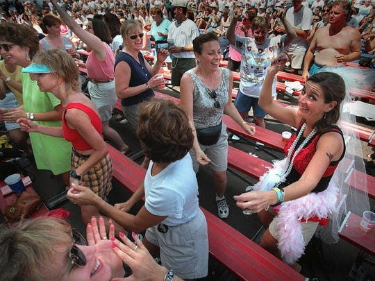 Therese Degnan, (right), of Lombard, Ill. dances to the music at the Miller Oasis at Summerfest in 1998.