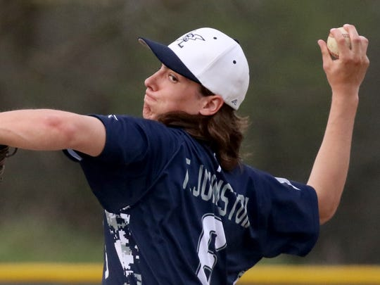 Lake Country Lutheran's Tyler Johnston pitches against