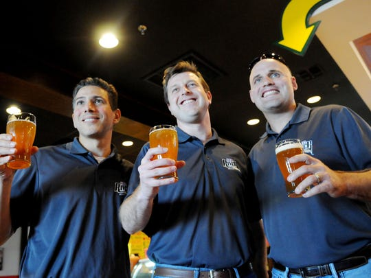 Robert McGuire (from left), Jared Beville and Beau Raines, owners of Red River Brewing Co., get together at Rotolo's.