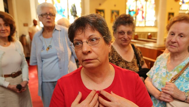 Lorraine Castagnoli express her sadness and disappointment at the closing of St. Ursula's in Mount Vernon July 2, 2015. The church will be merging with Sts. Peter & Paul.