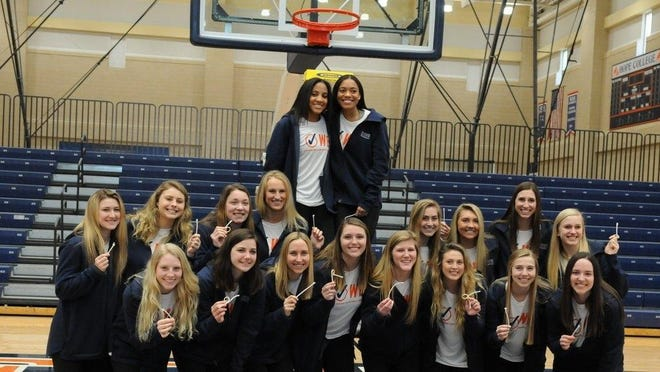 The Hope women's basketball team poses together after hosting a celebration of their season.