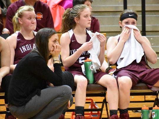 Southern Fulton senior starters, Olvia Mottern, left, Emily Bradshaw, middle, and Maddie Baker, right, sit behind coach Meagan Mellott in the final minutes of the PIAA Class 1A girls basketball second-round game against Jenkintown. The Indians fell 57-27.