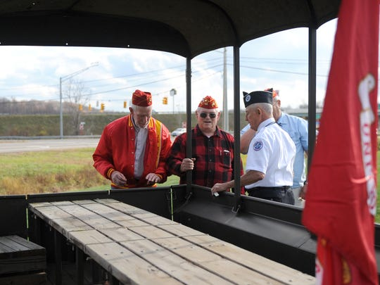 Members of the Korean War Veterans Chapter and Marine Corps League inspect the trailer attached to the 1952 Jeep Thursday afternoon.