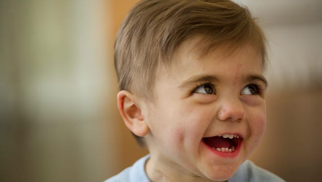 Luke Chapman, 23 months, enjoys watching his sisters, twin Kate and Avi, 6, play according to mom, Jamie Chapman. The youngster was born with hypo plastic left heart syndrome and has since had a heart transplant.