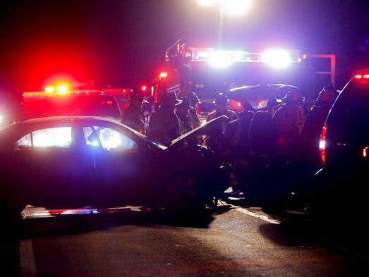 New Castle County Police and firefighters work at the
