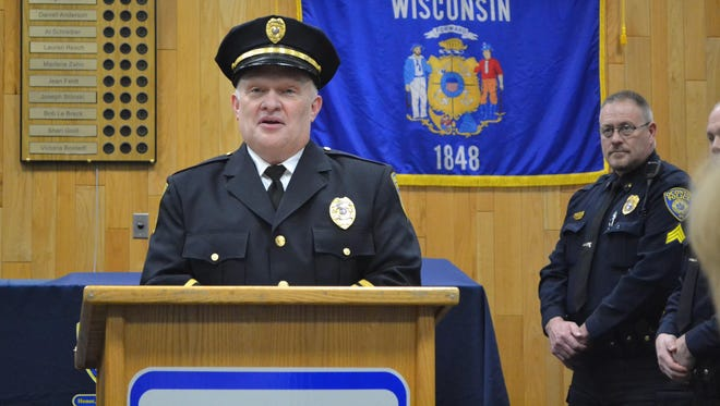 Bernie Faith speaks after being sworn in as Oconto police chief on Jan. 16. Faith was placed on adminstrative leave by the Oconto Police and Fire Commission on June 25. Sgt. Randy Van Hulle, right, is in charge of the department in the meantime.