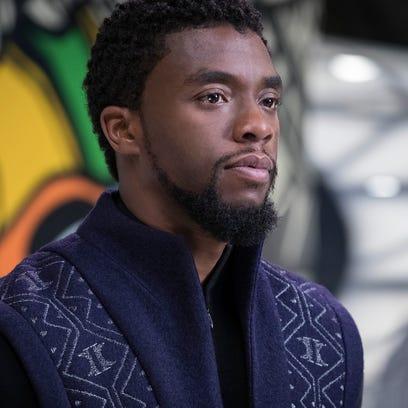 T'Challa (Chadwick Boseman) takes the throne of Wakanda