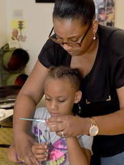 Nia Henry teaches her daughter, Thorne LaCroix, ,the