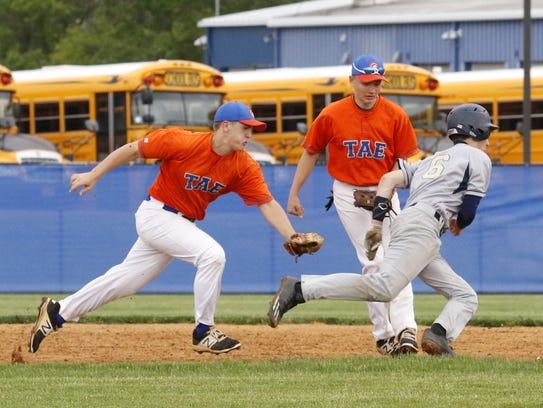 Edison third baseman Josh Tryon tags out Elmira Notre