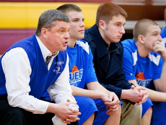 Steve Monks coaches the Horseheads boys basketball team during its victory at Ithaca last week. Monks became the school's winningest basketball coach with the victory. SIMON WHEELER / STAFF PHOTO