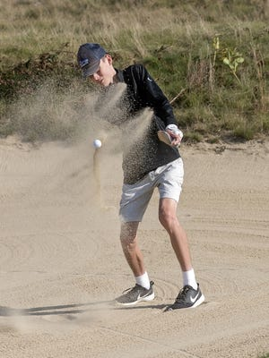 Carter Dailey gets a clean swing to get out of the sand.