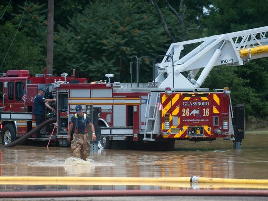 Glassboro Fire Department works on flood clean-up after heavy rain flooded Triad Apartment complex at Rowan University in Glassboro