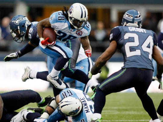 Running back Chris Johnson (28) finished off his 2,000-yard