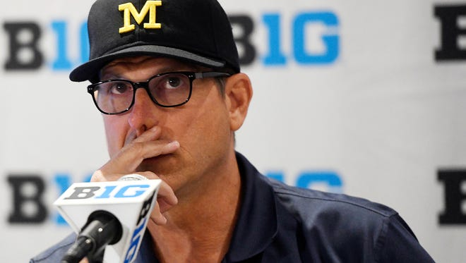 Michigan coach Jim Harbaugh has a 1-5 record against Ohio State and Michigan State through his first three seasons.