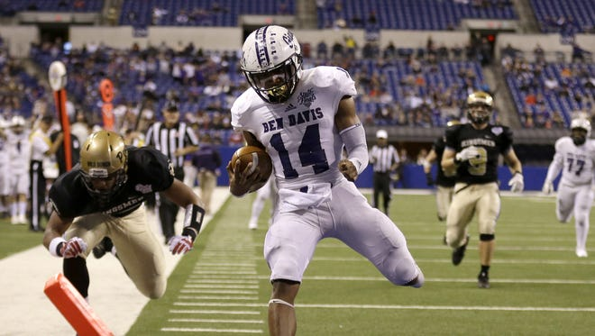 Ben Davis Giants Johnny Adams (14) scores a touchdown against the Penn Kingsmen in the first half of their IHSAA 6A State Football finals game at Lucas Oil Stadium Saturday, Nov. 25, 2017.