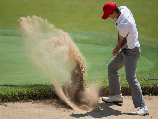 Mater Dei's Michael McAtee fires out the bunker and on to the 10th green during the IHSAA Boys' Sectional at Oak Meadow Country Club.