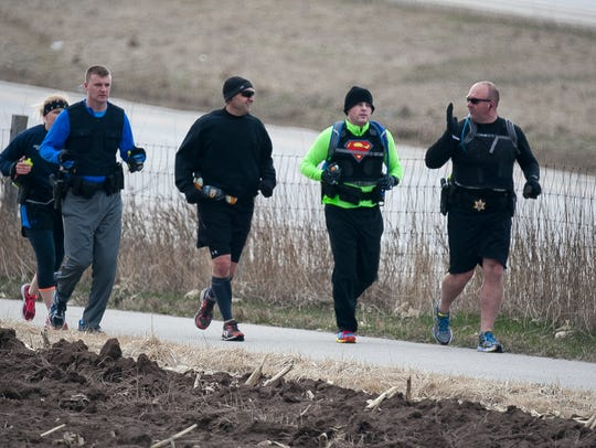Police officers train on Old Plank Road Trail near