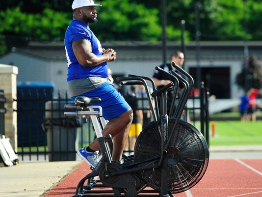 Buffalo Bills defensive tackle Marcell Dareus warms up on an exercise bike during an NFL football training camp in Pittsford, N.Y., Saturday, July 29, 2017. (AP Photo/Adrian Kraus)