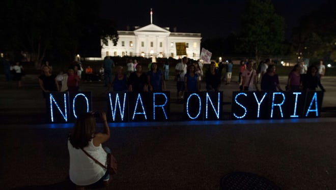 Anti-war demonstrators protest in front of the White House on Sept. 10.