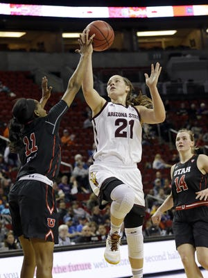 Freeport grad Sophie Brunner (21), shown shooting between Utah's Erika Bean (11) and Paige Crozon, is the No. 2 all-time leading rebounder and No. 3 scorer for Arizona State.