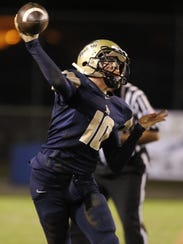 St. John Paul II quarterback Brian Woodend throws a