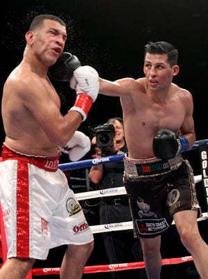 Hugo Centeno Jr. lands a straight right on Gerardo Ibarra during the fight card at Fantasy Springs Resort Casino on Friday. Centeno won the fight by unanimous decision.
