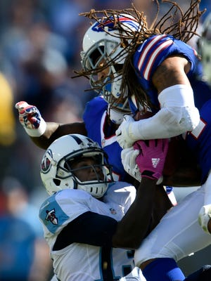 Bills cornerback Stephon Gilmore (24) intercepts a ball intended for Titans wide receiver Kendall Wright (13) late in the fourth quarter during their game at Nissan Stadium Sunday Oct. 11, 2015, in Nashville, Tenn.