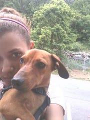 Julie Ritchie holds her medical companion dog Koko.