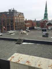 The roof of Burlington Town Center, foreground, is