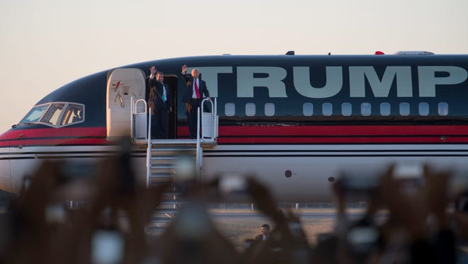 Republican presidential candidate Donald Trump disembarks his campaign jet with New Jersey Governor Chris Christie for a rally at Millington Regional Jetport Feb 27, 2016 in Millington, TN.