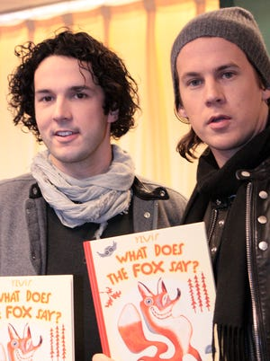 Ylvis (brothers Vegard, left, and Bard Ylvisaker) show off their children's book, 'What Does the Fox Say?' at a book signing Dec. 11 in New York.