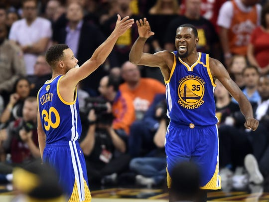 Stephen Curry and Kevin Durant celebrate during the