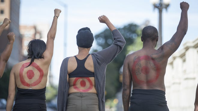 Part of the Point Blank protest, Indianapolis, Tuesday, Sept. 27, 2016. Rehema McNeil intends to take the project to a variety of cities, using local people to help her play the part of the red-painted targets.