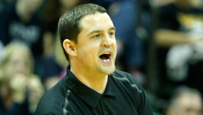 ORLANDO, FL - DECEMBER 01:  Head coach Brandon Miller of the Butler Bulldogs speaks to his team in a game against the LSU Tigers during the Old Spice Classic at HP Field House on December 1, 2013 in Orlando, Florida.  (Photo by Sam Greenwood/Getty Images)
