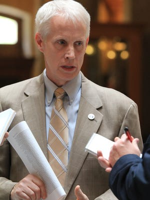 House Education Chairman Robert Behning speaks with reporters at the Statehouse. Behning's decision to start an education lobbying firm comes as lawmakers are looking at sweeping new ethics rules.